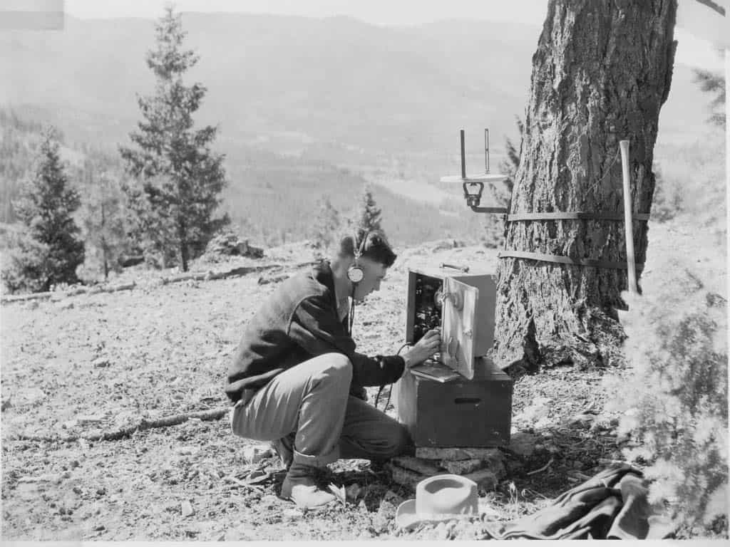 University of Montana student Richard Ogg using an SP Radio at a temporary lookout, c. 1935. Ogg was assigned to the Region 1 Mobile Radio Unit.